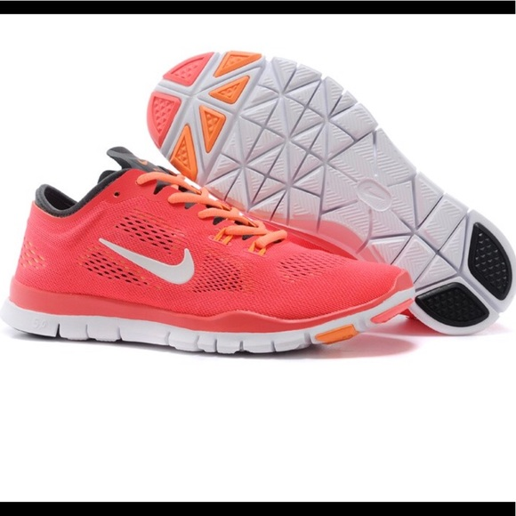huge selection of 92116 e1d18 Women s Nike Free TR 4 Orange Pink White Training